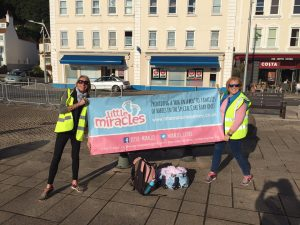 Cirsty and Sarah with the LM Banner in St Aubins